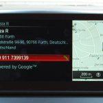 Detailansicht zu einem Sonderziel via Google-Suche im BMW-Navi. Zu sehen sind neben der Adresse auch die Telefonnummer, um direkt beim Restaurant anrufen zu können.