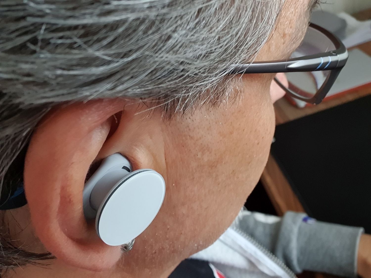 Surface earbuds in use