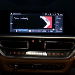 Startseite von BMW OS7 mit Auswahl des Fahrerprofils